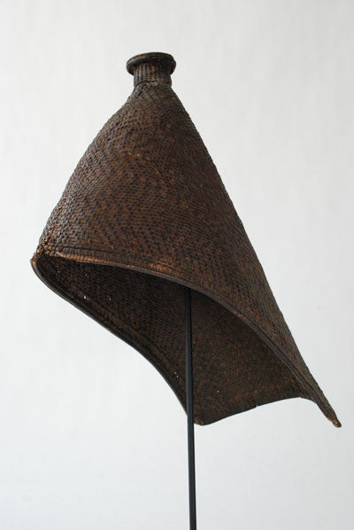 A thickly woven rain hat worn by women of Lugbara and Mangbetu tribes