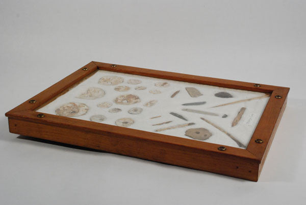 Southern California Indian artifacts in an old frame of prehistoric Chumash