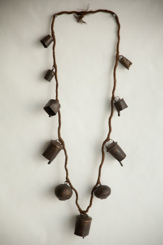 Naga Northeast India necklace comprising brass bells strung on twisted fibre