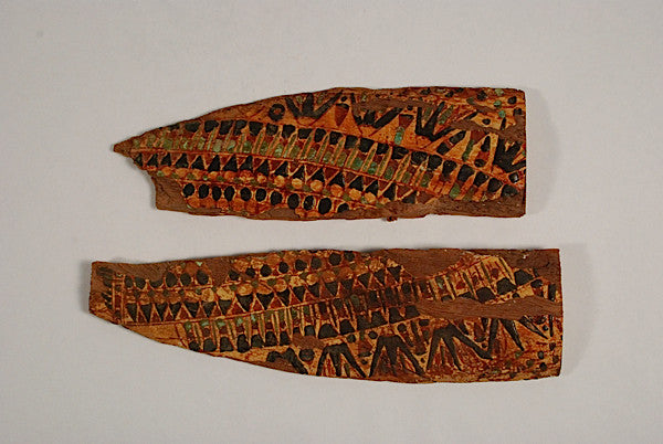 Two sections in painted wood from a pectoral collar