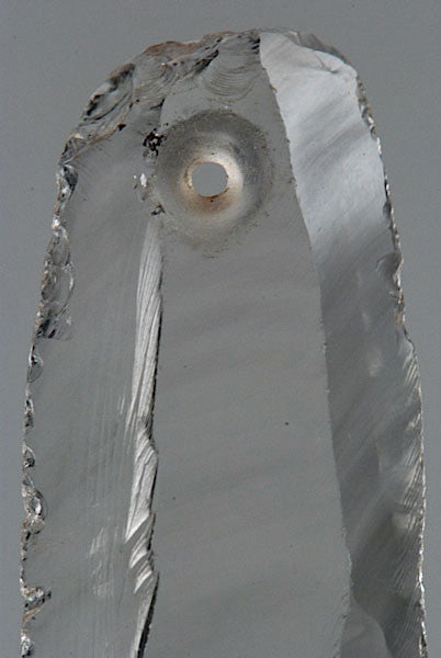 A drilled pendant, rock crystal, France, circa 6,500 BC, dolmen culture