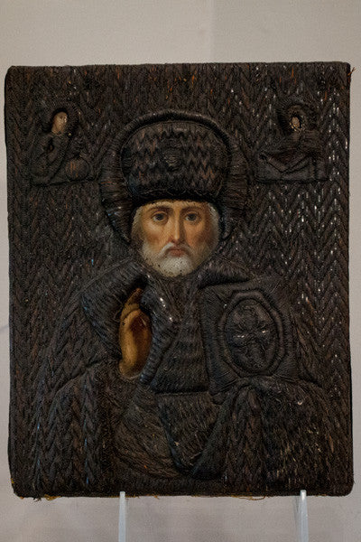Russian Icon painting depicting a Russian Saint with paint and woven textile