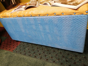 Blue wicker with yellow upholstered chest
