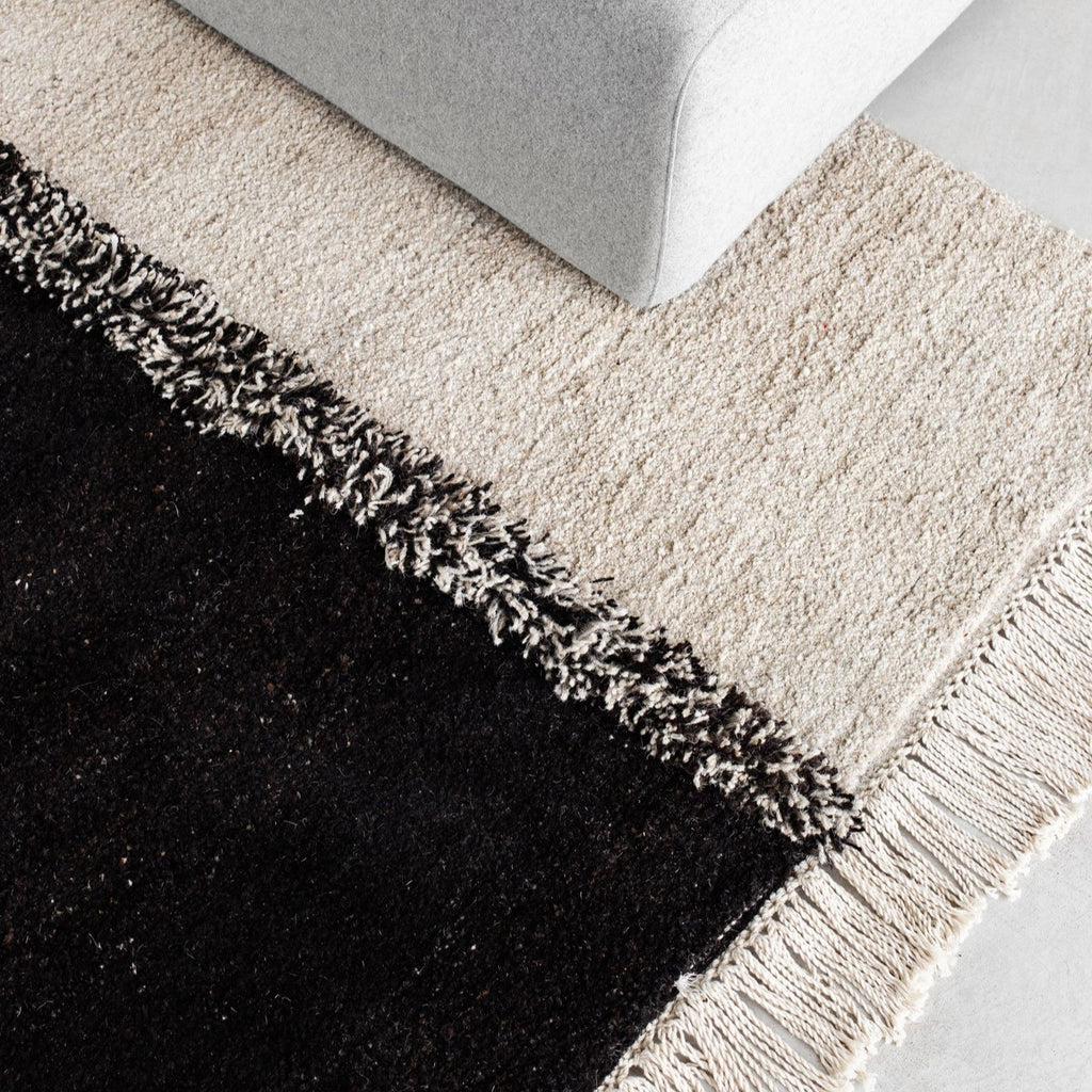 Sera Helsinki, Finnish designed hand-made rugs from Ethiopia, fair-trade, ethically made.  Available exclusively in  North America, Canada and USA, through Studio Nordhaven.  E-1027 knotted -  white + black