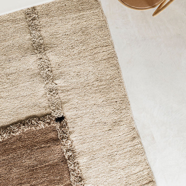 Sera Helsinki, Finnish designed hand-made rugs from Ethiopia, fair-trade, ethically made.  Available exclusively in  North America, Canada and USA, through Studio Nordhaven.  E-1027 knotted -  white + brown