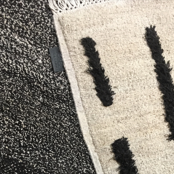 Sera Helsinki, Finnish designed hand-made rugs from Ethiopia, fair-trade, ethically made.  Available exclusively in  North America, Canada and USA, through Studio Nordhaven. Laine Knotted Wool Rug - Black + White - Saaristo Collection
