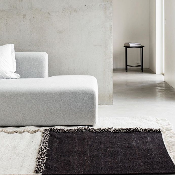 Sera Helsinki, Finnish designed hand-made rugs from Ethiopia, fair-trade, ethically made.  Available exclusively in  North America, Canada and USA, through Studio Nordhaven. E-1027 Hand Woven Rug - White + Black