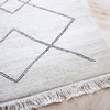 Sera Helsinki, Finnish designed hand-made rugs from Ethiopia, fair-trade, ethically made.  Available exclusively in  North America, Canada and USA, through Studio Nordhaven.  Kide - Hand Knotted - White + Black - Juuret Collection