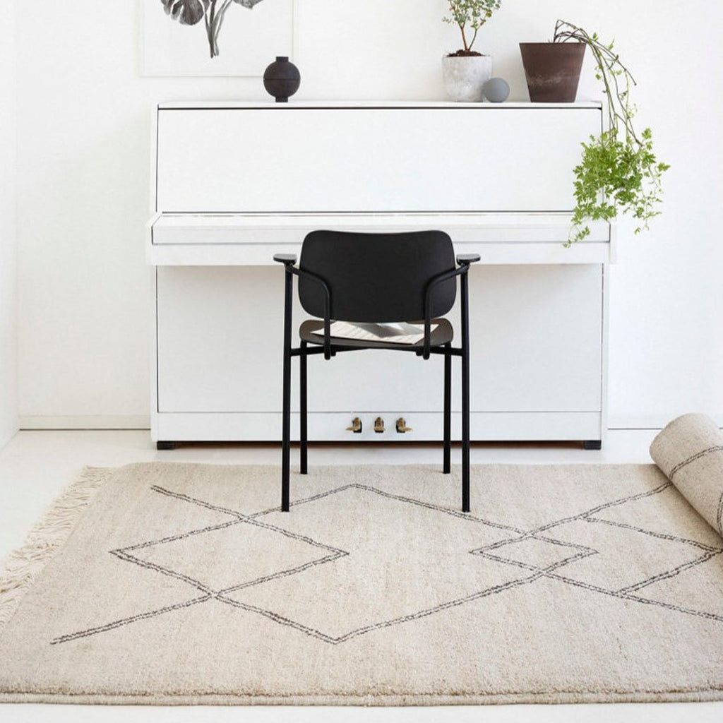 Sera Helsinki, Finnish designed hand-made rugs from Ethiopia, fair-trade, ethically made.  Available exclusively in  North America, Canada and USA, through Studio Nordhaven. Kide black & white wool rug - Juuret Collection