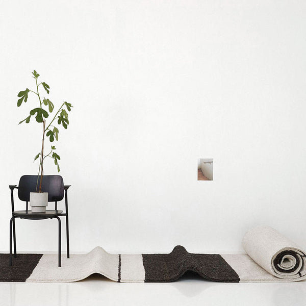 Sera Helsinki, Finnish designed hand-made rugs from Ethiopia, fair-trade, ethically made.  Available exclusively in  North America, Canada and USA, through Studio Nordhaven.  Aava Rug Knotted White & Black - Juuret Collection