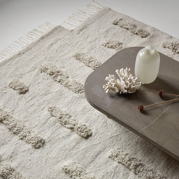 Sera Helsinki, Finnish designed hand-made rugs from Ethiopia, fair-trade, ethically made.  Available exclusively in  North America, Canada and USA, through Studio Nordhaven. Laine Woven Rug - White + White - Saaristo Collection