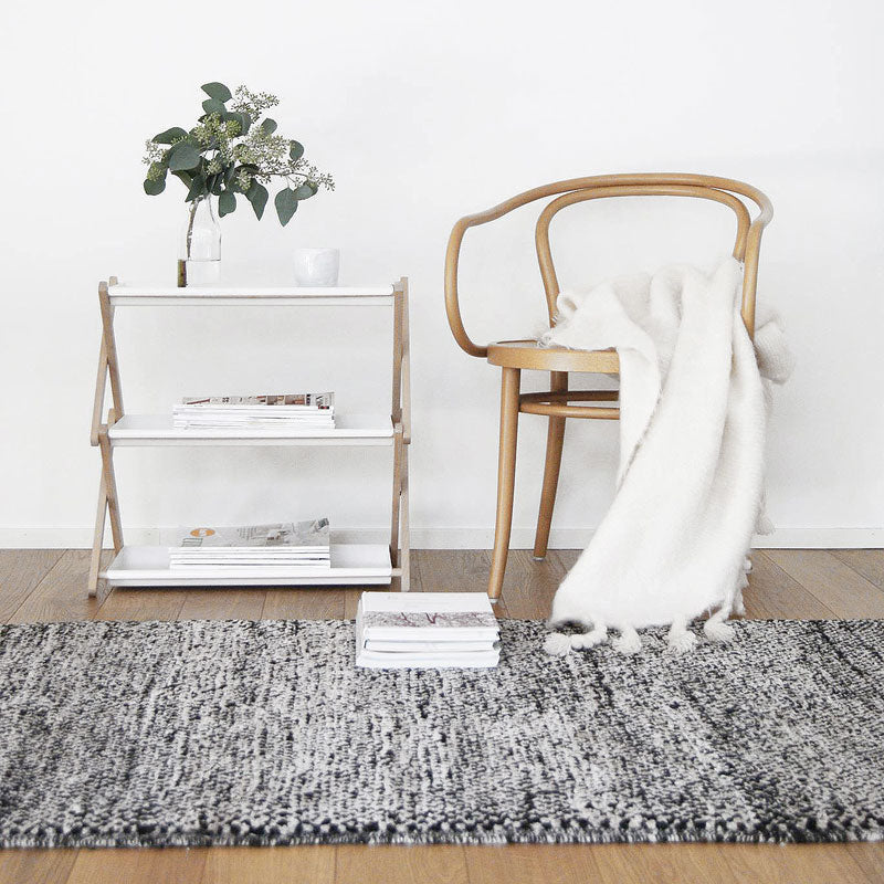 Sera Helsinki, Finnish designed hand-made rugs from Ethiopia, fair-trade, ethically made.  Available exclusively in  North America, Canada and USA, through Studio Nordhaven. Tuohii Knotted Wool Rug - White + Black - Juuret Collection