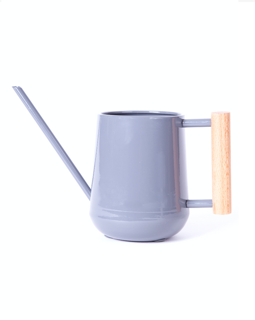 Greenery Australia modern charcoal watering can with a slender spout that creates a modern design with the beech handle for the grip. Made by Burgon & Ball, UK who specialise in steel.Powder coated steel with FSC beech handle. Product Dimensions.Height 10cm.Depth 12cm.Width 25cm.Capacity 0.7 litres