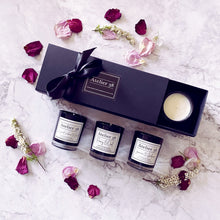 Load image into Gallery viewer, Black gift box of 3 votives. Floral scents: Jasmine & Gardenia; Peony & Oud; Bergamot, Verbena & Basil.