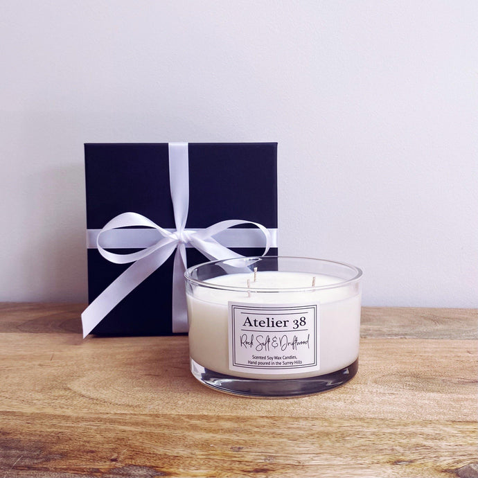 Large clear glass soy wax candle, 3 wick, Rock Salt & Driftwood fragrance.