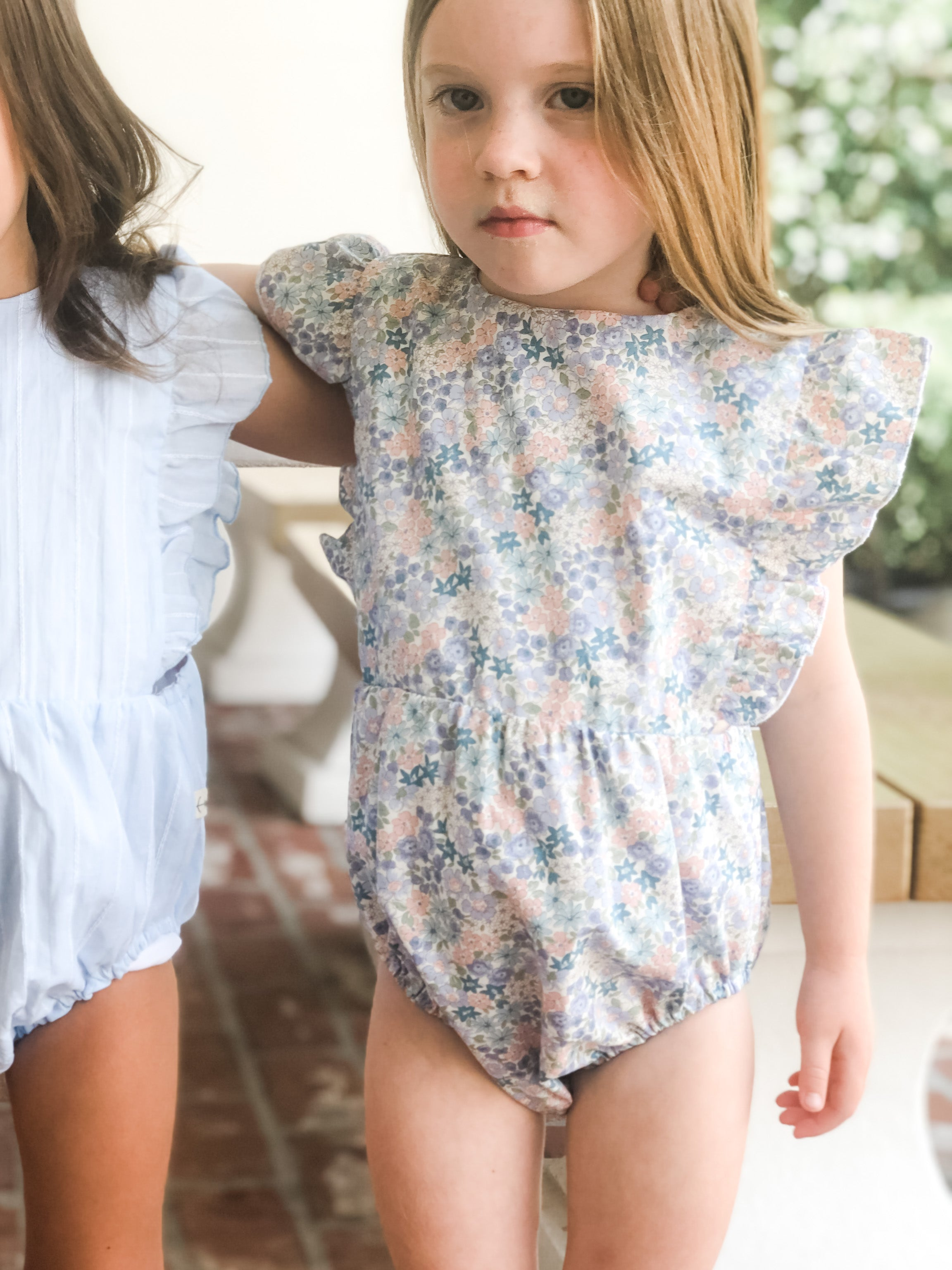 Ruffle sunsuits in the Color Bloom and Pool.