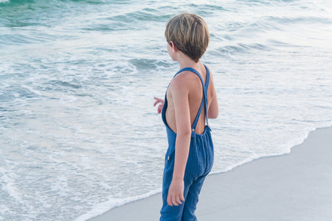 Watching the waves while wearing our super soft double gauze overalls in Ocean.