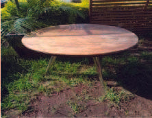 Three legged steel table with wooden top (Diameter 1.0mtr)