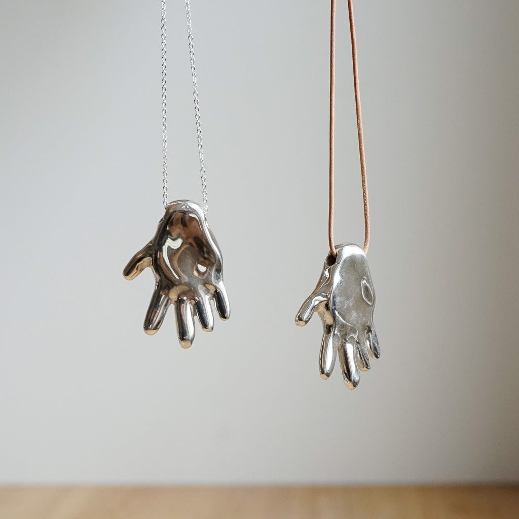 Gilded hand necklace, solid sterling silver
