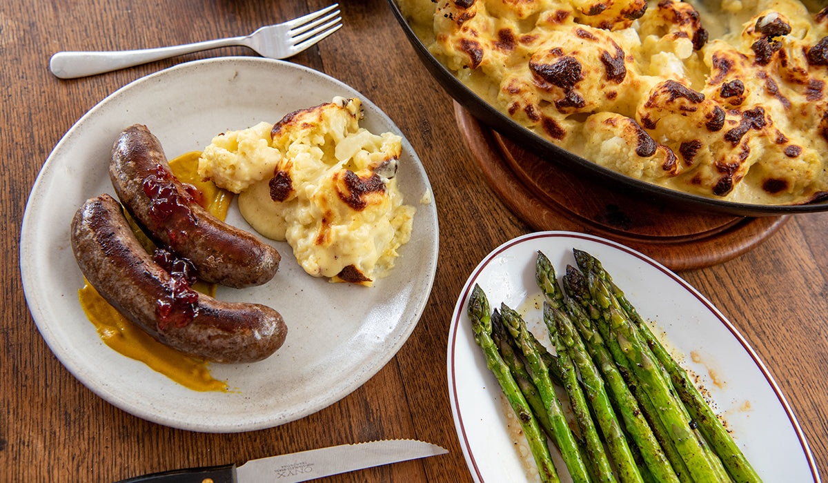 Venison sausages with cauliflower cheese