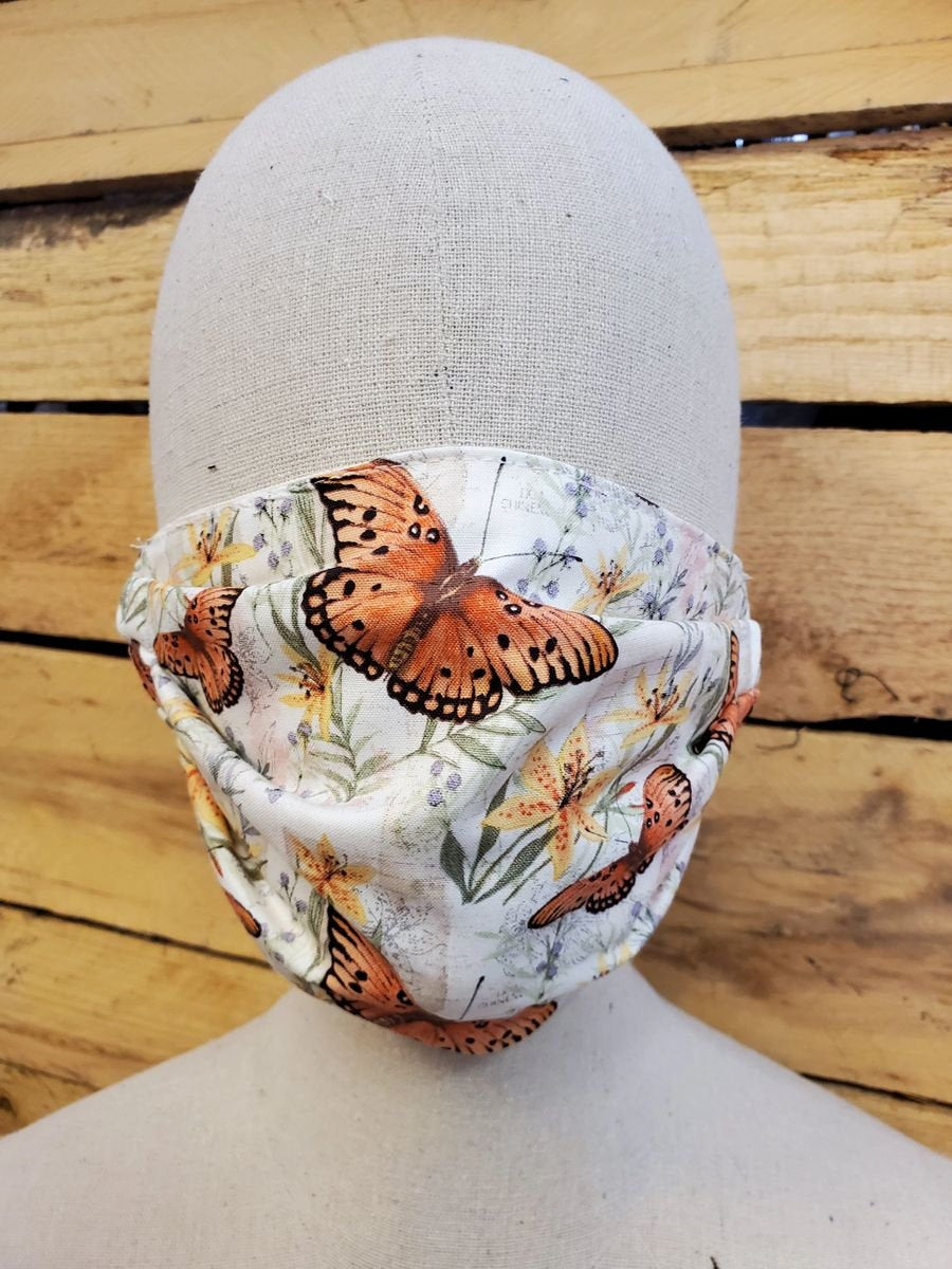 Butterfly face mask with slot for filter