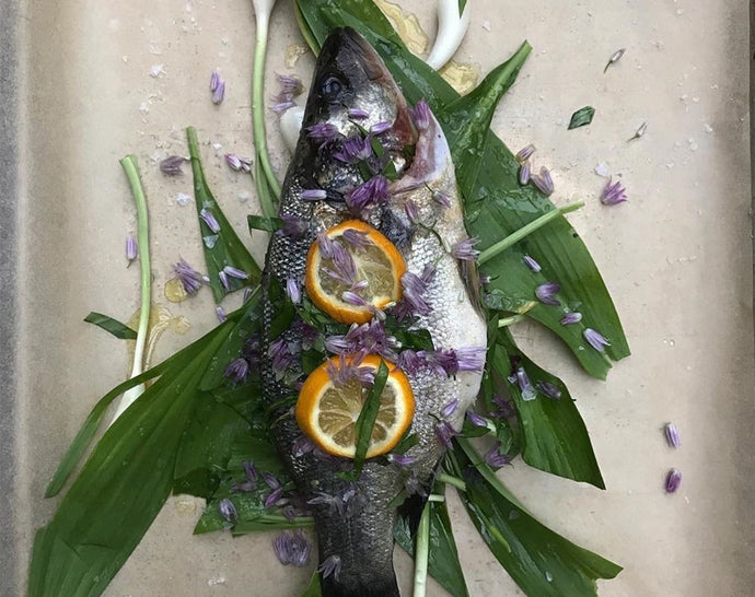 Oven Roasted Whole Branzino with Ramps, Meyer Lemon, & Chive Blossoms
