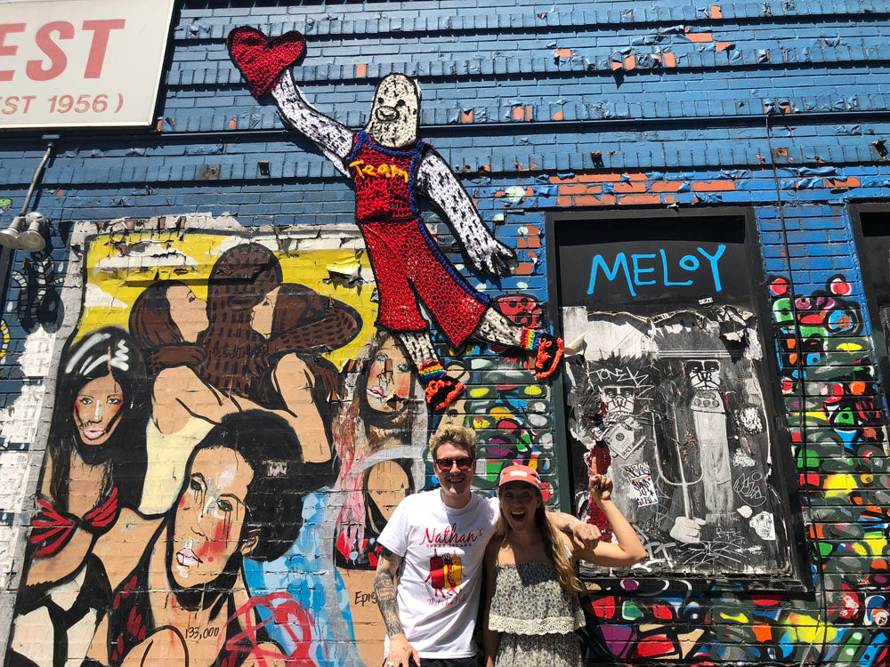 Image of London Kaye and Brandon Sines infront of Frank Ape piece - Billymarks West