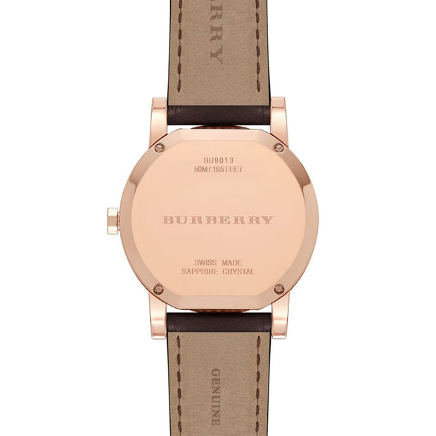 Brand: Burberry Series: Taupe Model: BU9013 Gender: Men's Movement: Quartz Water Resistance: 50 meters / 165 feet Features: Gold, Leather, Stainless Steel