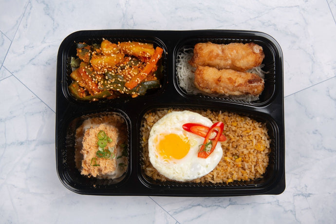 Nasi Goreng Bento with Sunny Side Up Egg, Pickled Achar,  Crispy Mango Prawn Roll and Japanese-style Cold Tofu
