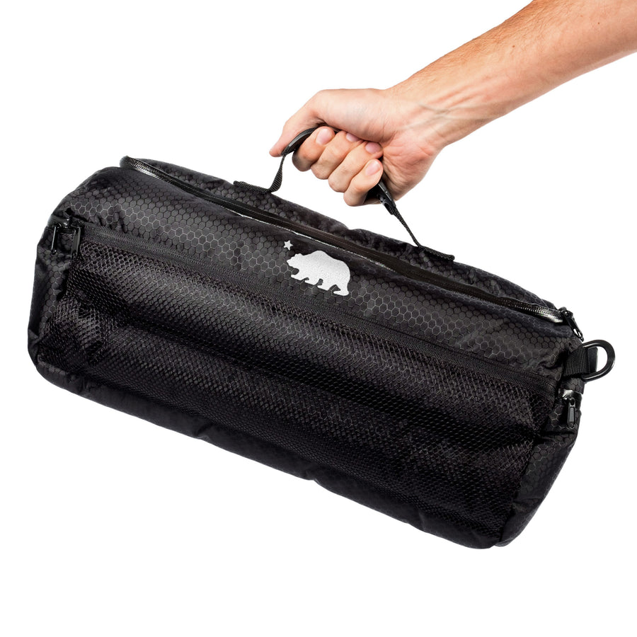 Large duffle in hand