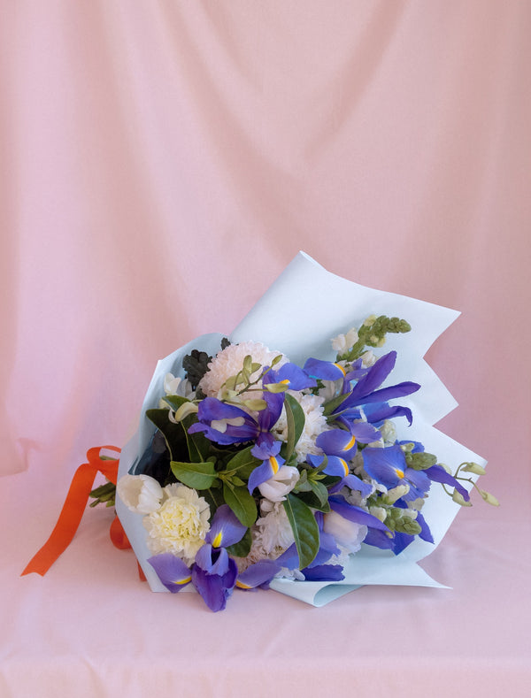 Blue Iris and White Flower Bouquet, Blue Wrapping and Orange Ribbon.