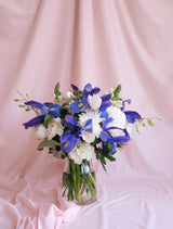 Blue Iris, White Orchids, Carnations and Mums in Vase.