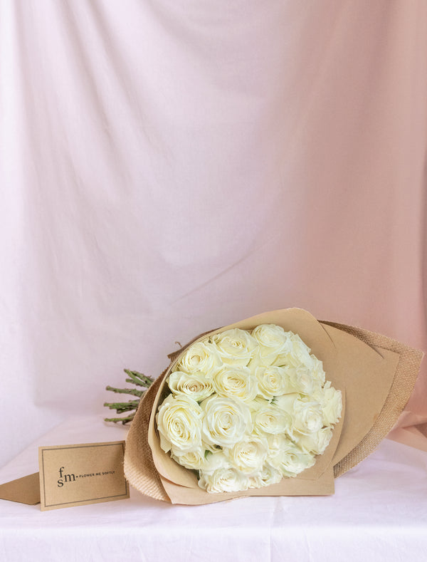 White roses wrapped in burlap. Roses delivery Melbourne by Flower me softly.