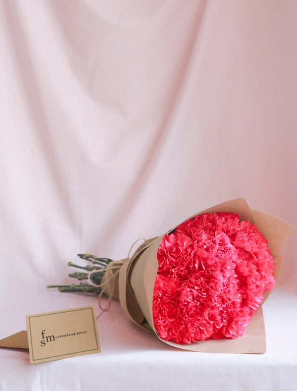 Carnations hot pink bouquet burlap wrap Flower delivery melbourne.jpg