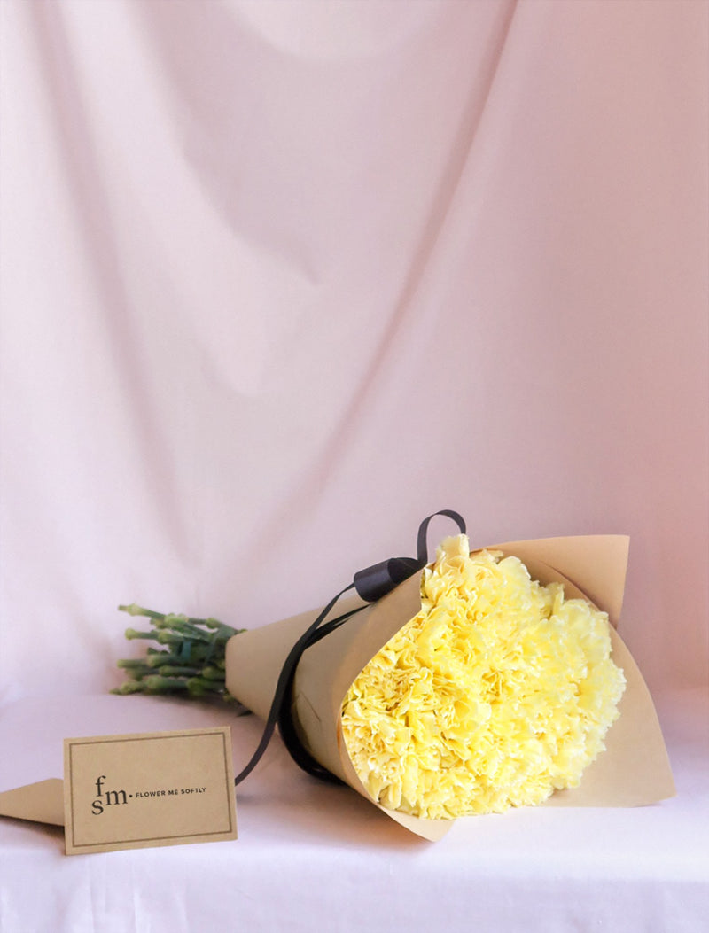 Yellow Carnations only in  kraft wrapping and black ribbon. Delivery in Melbourne.