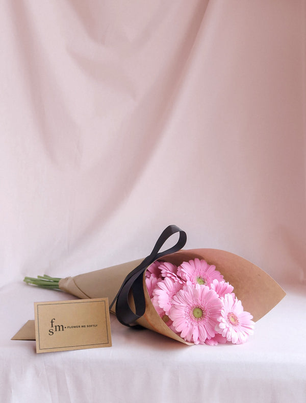 Gerbera daisies pink flower bouquet wrapped in kraft brown black ribbon. Flower Me Softly Melbourne Florist card.
