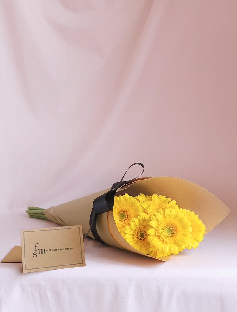 Gerbera daisies yellow flower bouquet wrapped in kraft brown black ribbon. Flower Me Softly Melbourne Florist card.
