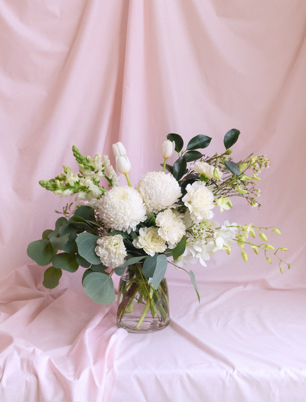 Green and White Flowers in Premium Vase.