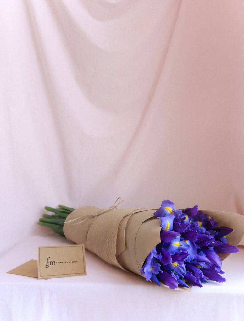 Iris blue hessian wrapped bouquet with card.