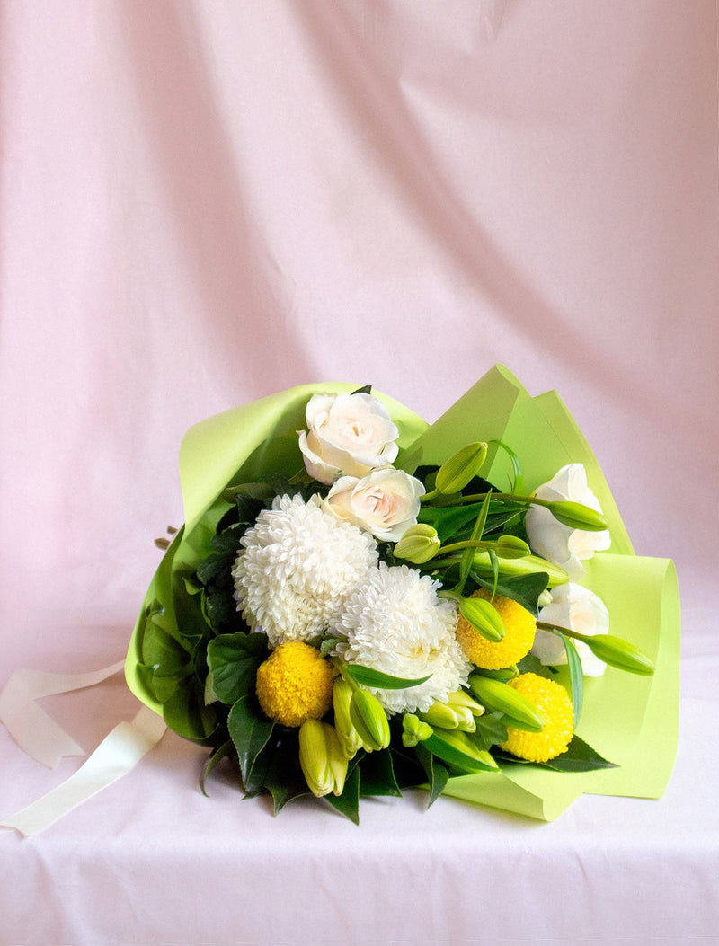 Rose, Lillies and Mums in Green Wrap and White Ribbon.