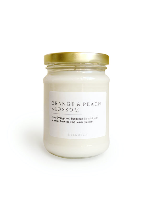 Orange and peach blossom scented soy candles delivered in Melbourne with Flowers
