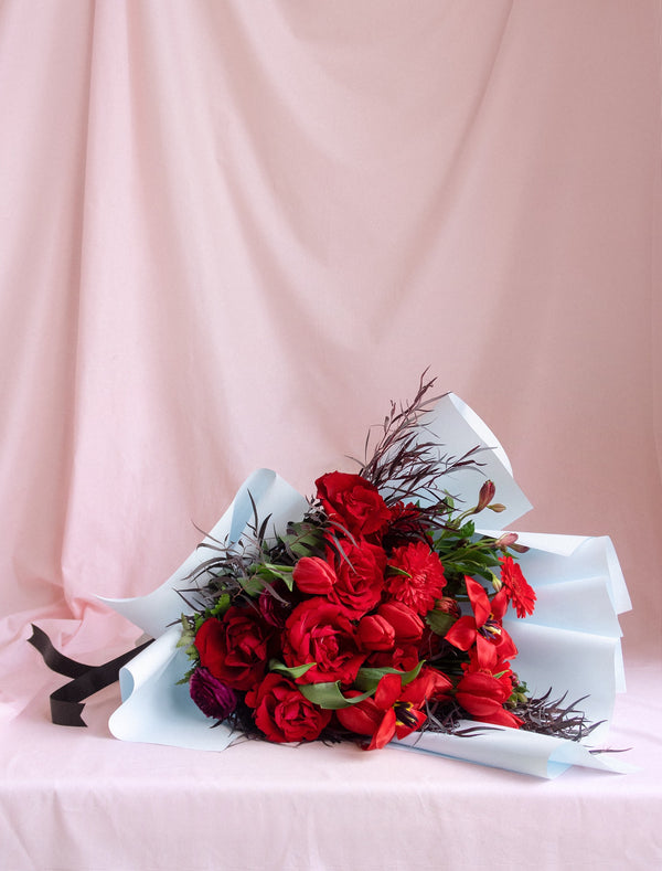 Premium Red Colour Flower Bouquet Wrapped in Blue Black Ribbon for Delivery in Melbourne
