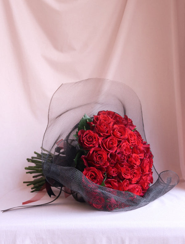 Red Premium Rose Valentine Day Bouquet Wrapped in Black Net and Red Ribbon. Flower Me Softly