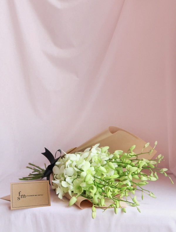 White Orchids Bouquet, brown kraft wrapping, black Ribbon, Flower me Softly Message Card,delivery Melbourne