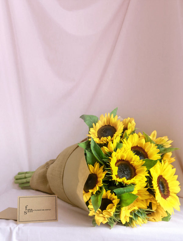 Sunflowers bouquet wrapped in lovely hessian sheet, flower delivery Melbourne.