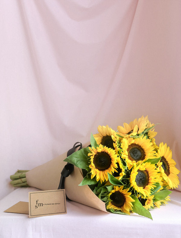 Sunflowers bouquet wrapped in crisp kraft paper, flower delivery Melbourne.