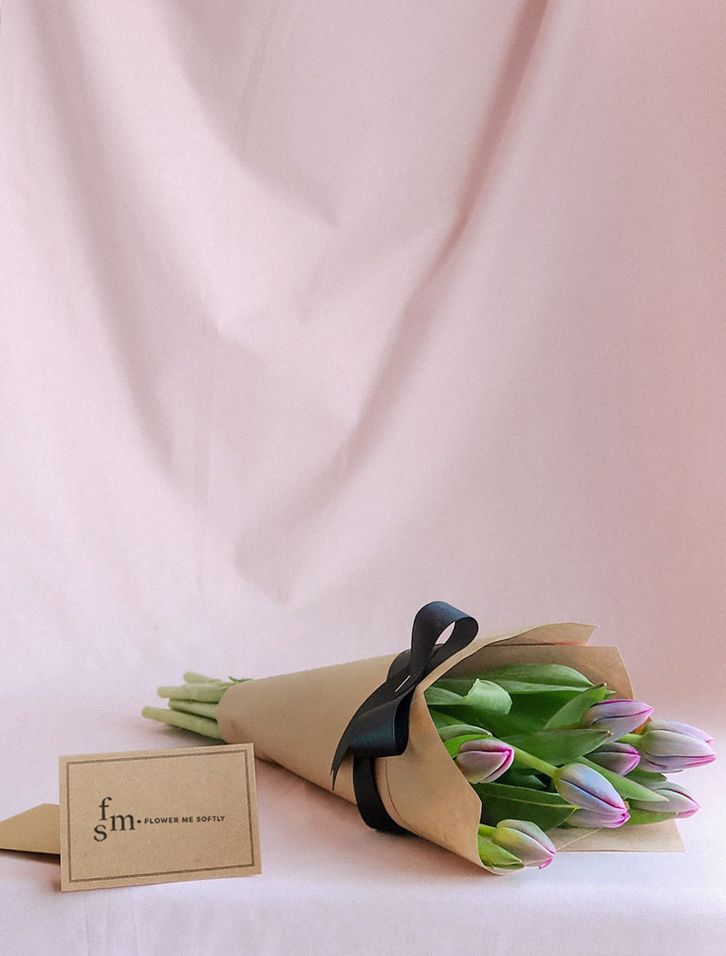 Purple Tulips flowers small bouquet wrapped kraft paper black ribbon. Flower Me Softly florist shop.