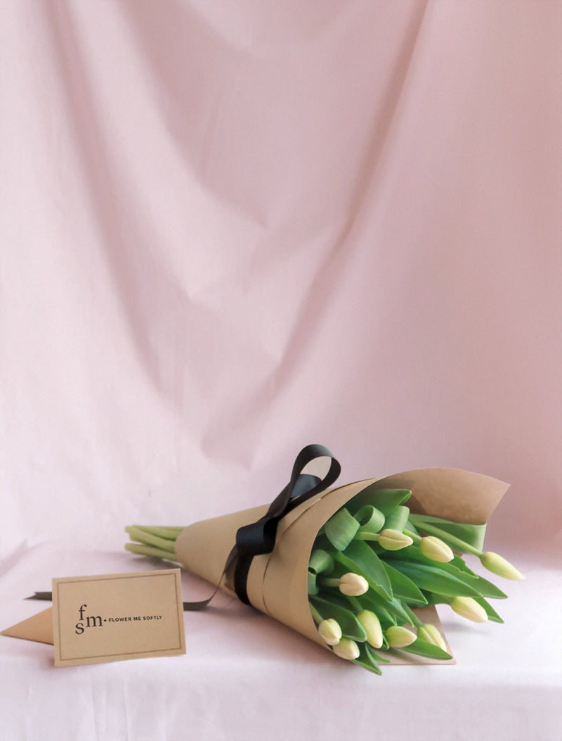 White Tulips flowers small  bouquet wrapped kraft paper black ribbon. Flower Me Softly Melbourne Florist.