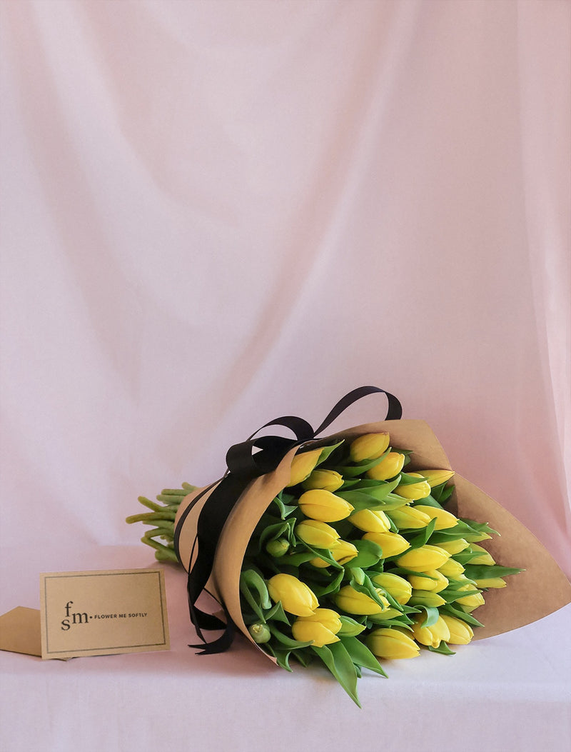 Yellow Tulips flowers large bouquet wrapped kraft paper black ribbon. Flower Me Softly Melbourne online shop.