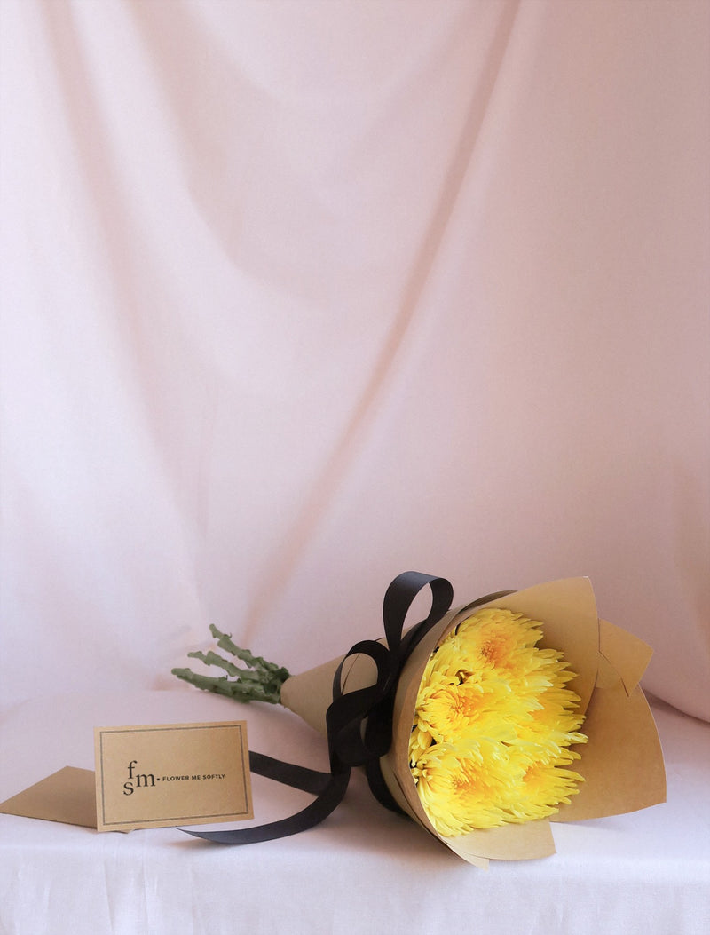 Chrysanthemum Spider Yellow Disbud Mum Bouquet. Wrapped brown kraft paper black ribbon. Flower Me Softly florist card Melbourne delivery